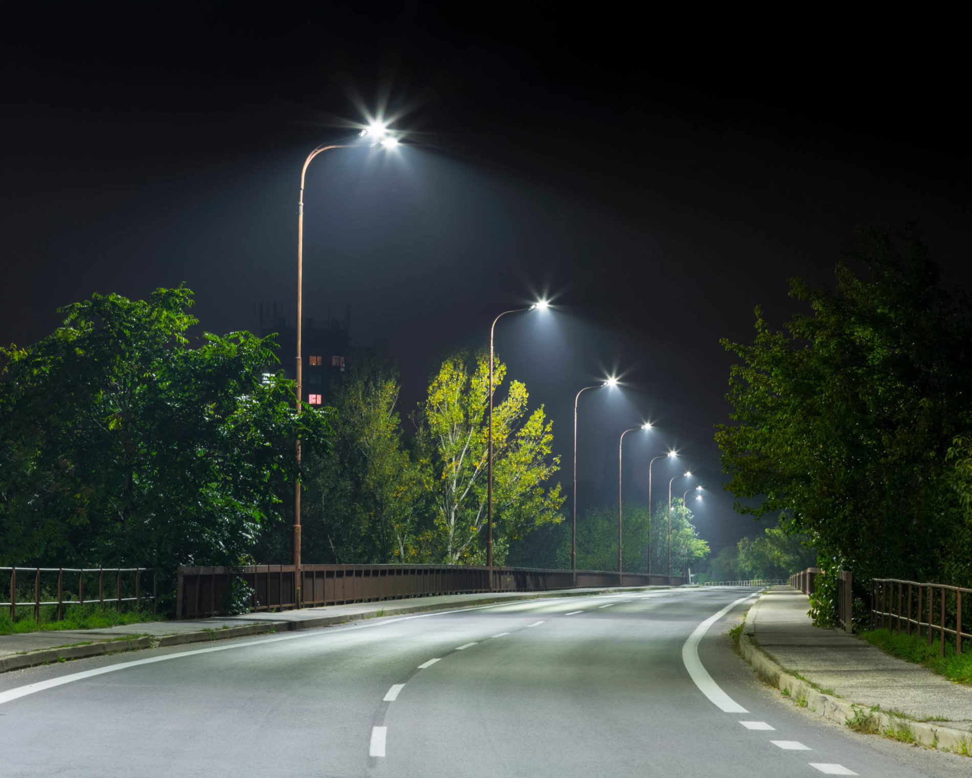 Streetlights along road at night