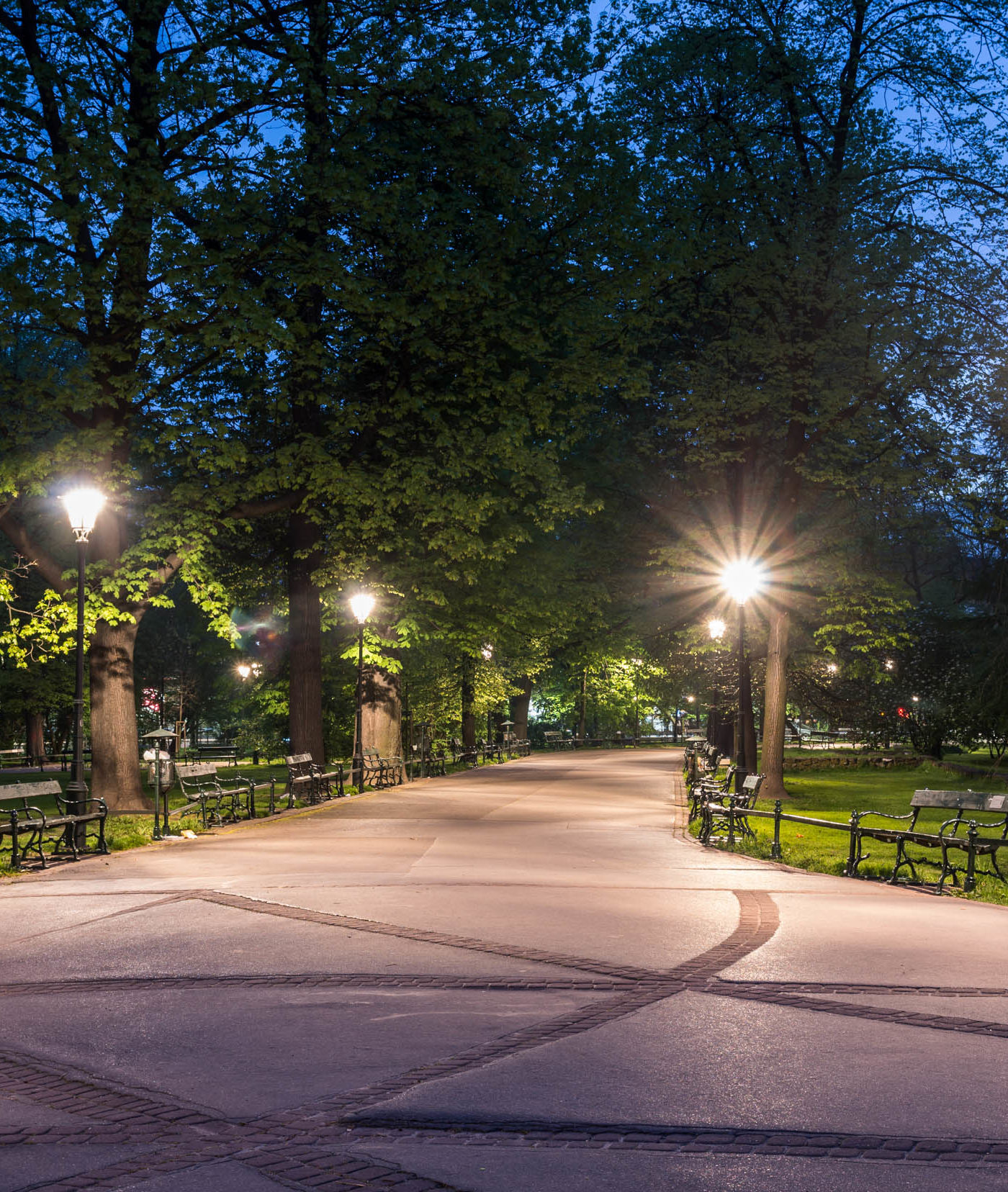 City park path at dusk lighted by LED lights