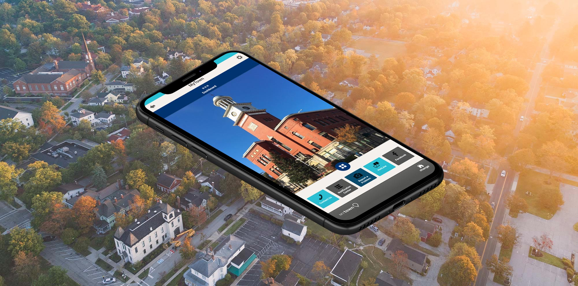 Smartphone with MyTown over aerial photo of municipality